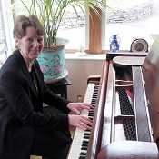 Photo: Dawn Smart playing the piano at Sharrow Bay hotel